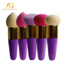 non-latex cosmetic sponge & purple plastic handle puff