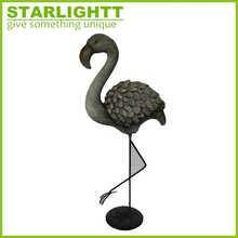 Resin bird figurine w/ vivid look & metal legs for home decor.