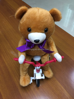 singing bear in tricycle