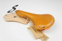 Leather bicycle saddle with copper rivet