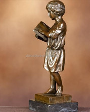 Children reading bronze statue
