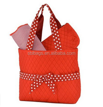 Watermelon red cotton shopping tote bag with metal feet at bottom outside bow-tie / beach tote bag with outside pockets