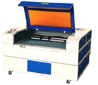 Hot sell!!! 50/60W Co2 wood/acrylic/farbic/leather laser cutting engraving machine price