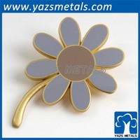 custom metal flower brooch