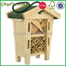 natural wooden insect hotel with asphalt shingle roof