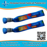 China party festival supplier custom printed wristband/bracelet design own logo with the only way to remove them