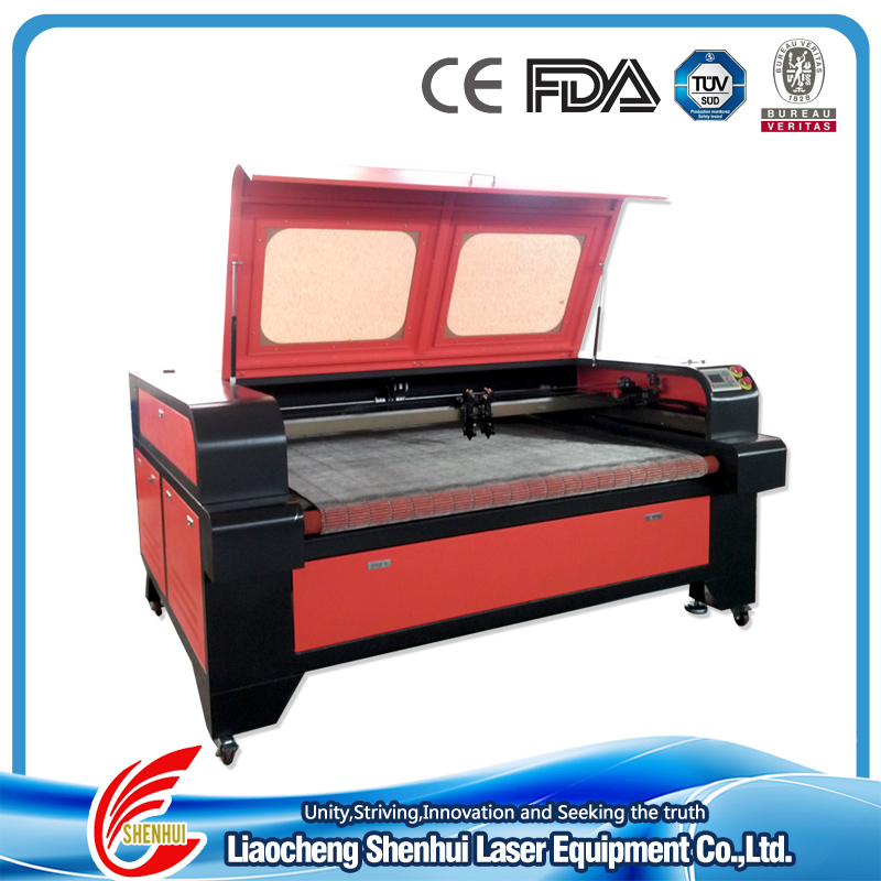 OEM Best Price Fabric/Leather/Jeans/Cloth Co2 Auto Feeding Laser Cutting Machine SH-1610 for Sale