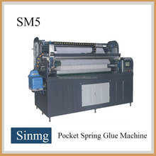 Continuous and interrupt mode pocket spring glue machine