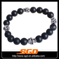Stretch 4 skull charms onyx bracelet with beaded