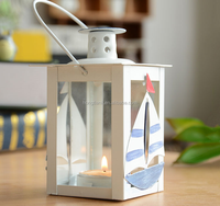 white portable sea shell candle holder