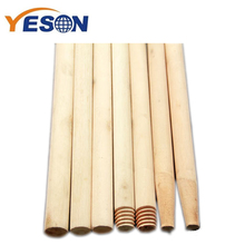 natural wooden broom handle with small sticker