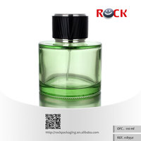 High quality CE/ISO cylindrical green glass perfume bottle 100ml with PP+ABS black cap provide free sample
