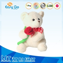 White teddy bear toy with red rose for Valentine's gift