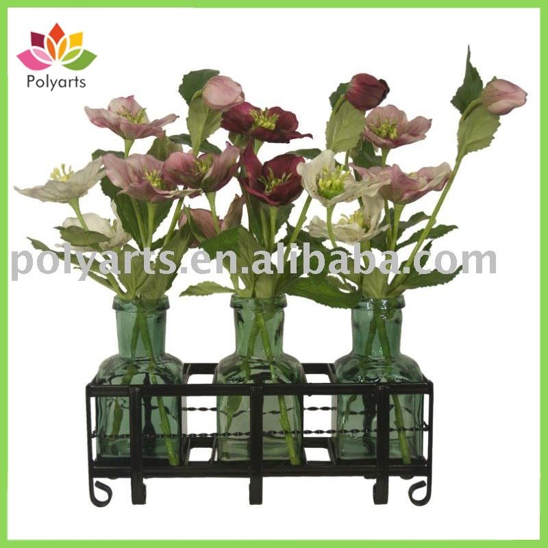 flower arrangement with grass and metal rack