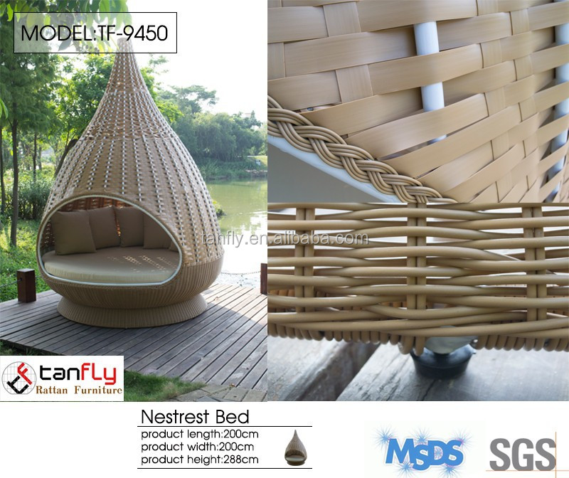 Hanging outdoor lounger over-sized bird's nest rattan lounge bed.