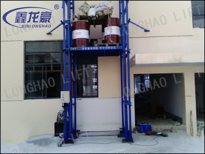 Outdoor Indoor cargo delivery guide rail hydraulic lift for sale
