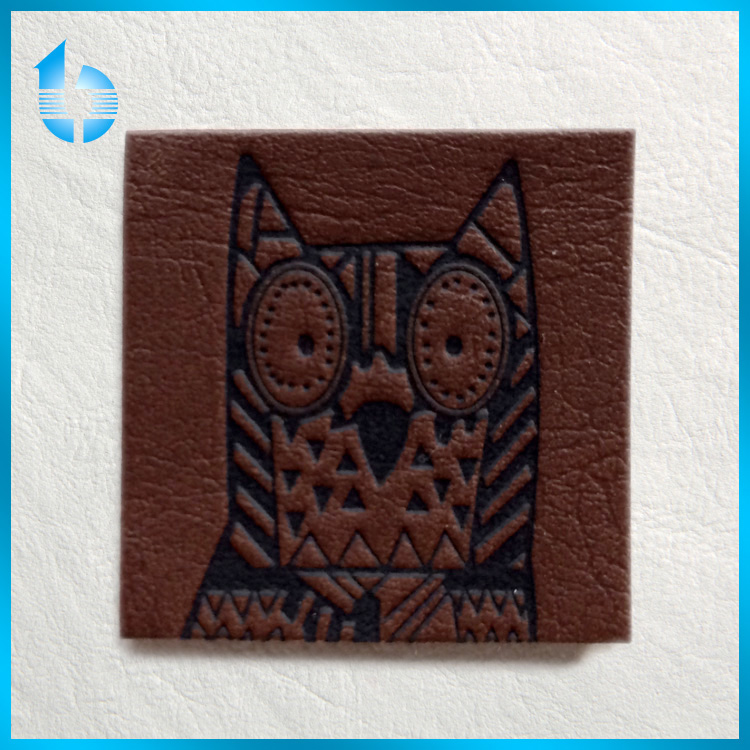 Lovely embossed owl pattern imitation leather label for garments