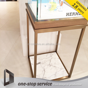 Foshan Factory Exclusively Designed MDF Acrylic Edged with Brushed Metal Tabletop Display For Wrist Watch Showroom Decoration