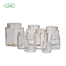Customized size reusable clear durable hexagonal glass honey jar with metal lid