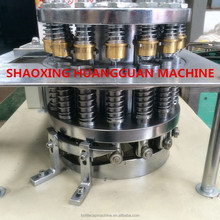PLASTIC CAP FOLDING MACHINE