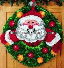 Christmas craft kit with a Santa Claus design latch hook rug kit