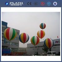 hanging helium balloon flying in the sky, inflatable advertising colourful balloon