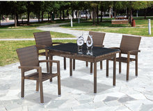 High back rattan garden chair and rectangular table dining furniture