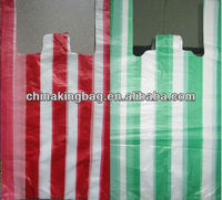 white and green striped plastic t shirt bag