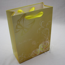 Factory price fancy bling bling golden paper gift bag with custom logo