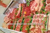 FRESH BEEF DISPLAYS IN SUPERMARKET MEAT DEPARTMENT SHOWCASES