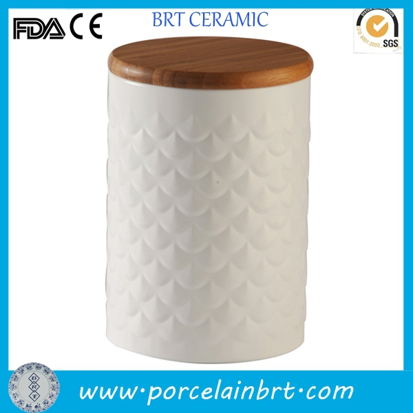 Custom size white embossed ceramic canister with wooden lid
