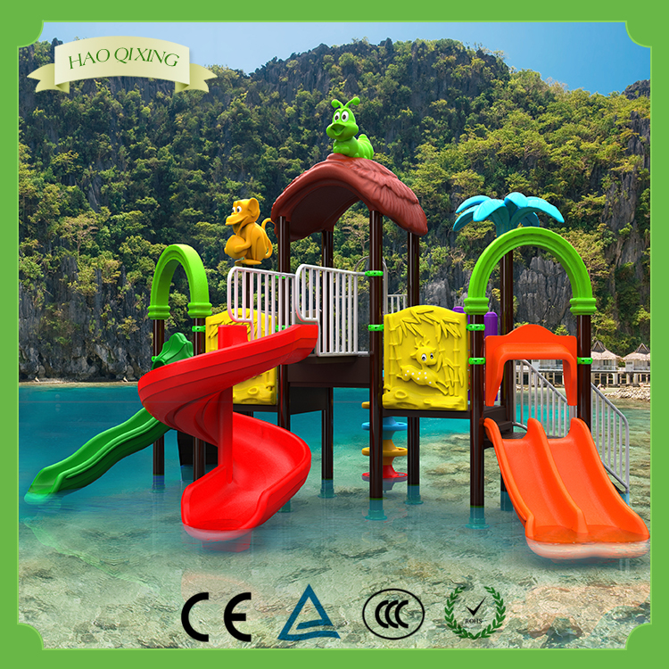 Large outdoor swimming pool with children's water slide