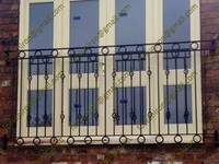 French wrought iron balcony railing with rings / circles designs