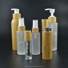 Wholesale 30ml 50ml 100ml 120ml 150ml bamboo stype cosmetic packaging frosted glass bottle with bamboo wooden lotion caps
