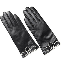 The new fashion bowknot ladies sheepskin gloves touch screen winter gloves