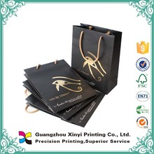 China manufacturer handmade gold handle cheap printed packaging candy paper bag