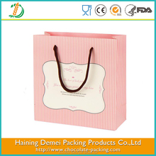 China high quality plastic cheap food kraft paper bag with different handle types with heart