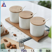 Ceramic spice jar with wooden lid and spoon, ceramic jar with wooden tray