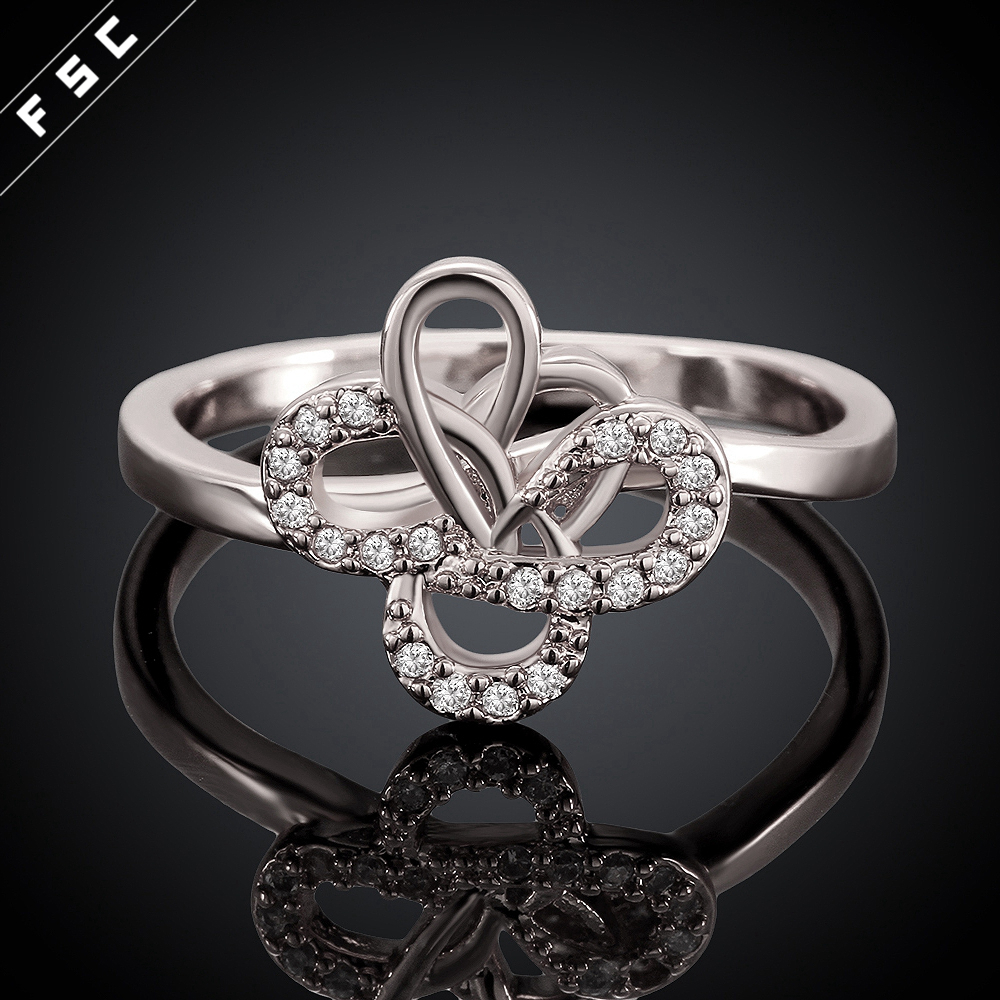 Eco-friendly cheap beautiful white gold plated flower shape wedding ring for girls with zircon