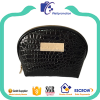 Black leather women cosmetic makeup bag with debossed logo