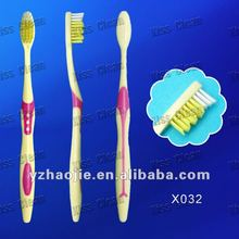 popular anti-slip handle and wave cut bristle toothbrush for adult