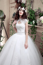 Hot White Tulle Puffy Bridal Gowns Floor Length Luxury Beaded Ball Gown Wedding Dresses 2016