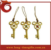 Nice key shaped gold phone charm