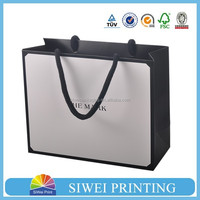 2016 custom cheap recycled decorate luxury branded bag design promotion paper storage bag for garment
