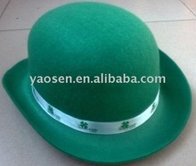 Green felt party bowler hat with shamrock print logo on the ribbon