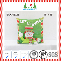 Red and green snowman cushion as christmas decoration for home