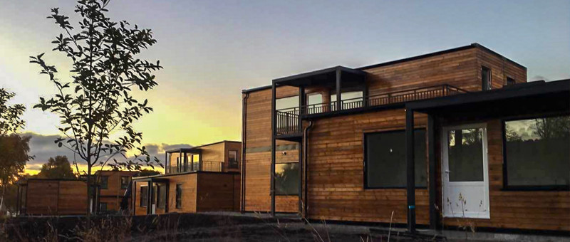 wooden house with container home