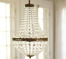 11.30-3 Dozens of sparkling CHANDELIER faceted-glass crystals cascade from antique-bronze rings embellished