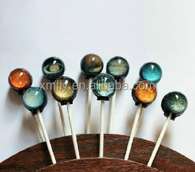 Handcrafted 3d lollipop with planet pattern design