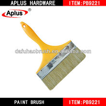 big yellow paint brush to paint a room